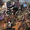 BRYAN EATON/ Staff Photo. Molly Ettenborough, recycling and energy coordinator for Newburyport and Edo Kombana of Small Solution Big Idea surrounded by recycled and refurbished bikes what will be sent to Kenya.