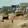 BRYAN EATON/ Staff Photo. Sand for the Salisbury Beach dune replenishment continued this week between public access point six and seven.