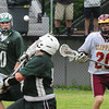 BRYAN EATON/ Staff Photo. Pentucket goalie Ben Smith deflects a shot by Newburyport.