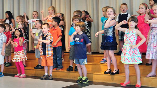 """BRYAN EATON/ Staff Photo. Kindergartners at Salisbury Elementary School perform in their """"graduation"""" assembly in front of parents on Monday afternoon. Tuesday is their last day with the rest of the school being released on Thursday for summer vacation."""