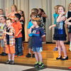 "BRYAN EATON/ Staff Photo. Kindergartners at Salisbury Elementary School perform in their ""graduation"" assembly in front of parents on Monday afternoon. Tuesday is their last day with the rest of the school being released on Thursday for summer vacation."