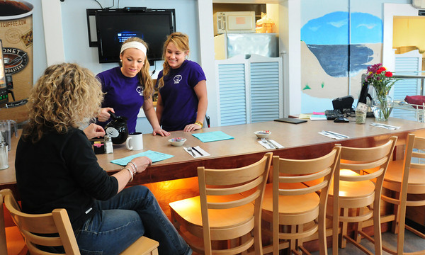 BRYAN EATON/ Staff Photo. Allie Helfrich, left, and Kate Farrell tend the counter at the reopened Plum Crazy on Plum Island.