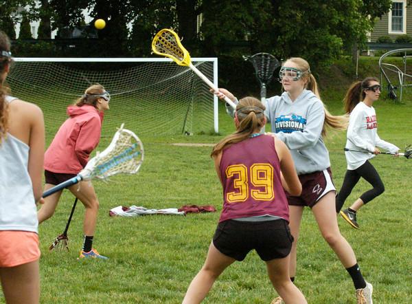 BRYAN EATON/ Staff Photo. Newburyport High girls lacrosse team practices yesterday.