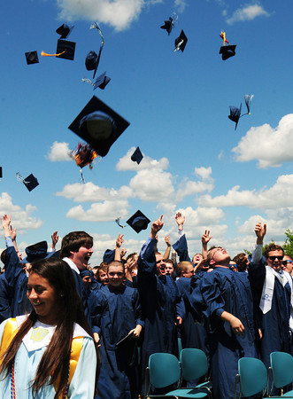 BRYAN EATON/ Staff Photo. Mortar boards come off at the end of the Triton Regional High School graduation.
