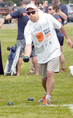 "BRYAN EATON/ Staff Photo. David Hall of Newbury lets go in a game of bocce at Cashman Park this weekend at ""Bands, Beer and Bocce."" The event was sponsored by Newburyport Charitable Causes with proceeds going to the Cancer Center at Anna Jaques Hospital."