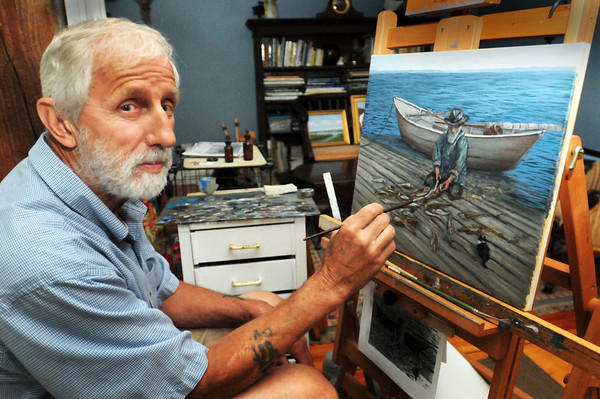 BRYAN EATON/ Staff Photo. Joppa native Herb Crooks, one time fisherman, now paints photos of the fishing industry with many scenes painted from that area of Newburyport. His present painting is this one of George Thurlow cleaning cod and pollack.