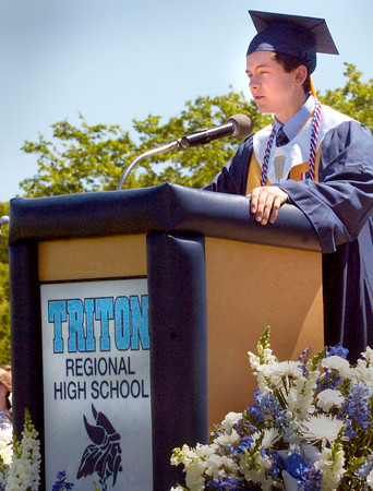 BRYAN EATON/ Staff Photo. Triton salatutorian Devon Shuman gives his address about the past.