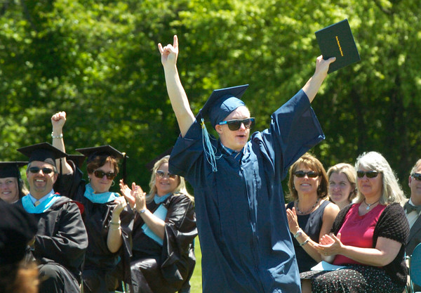 BRYAN EATON/ Staff Photo. Daniel Elliott shows how he feels about getting his diploma.