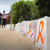 BRYAN EATON/ Staff Photo. Children at Salisbury Elementary School walked for their Mini-Relay For Life on Wednesday which raised money for the American Cancer Society. Here they walk along Bags of Hope that were decorated in memory of a loved one that died of cancer, is struggling with the disease or has survived it.