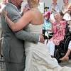 BRYAN EATON/ Staff Photo. Salisbury Assisted Living Center resident Rita Wilmont applauds as Jorge Ledesman and his new bride, Carment Perez, who's a CNA at the facility, dance after exchanging their vows.