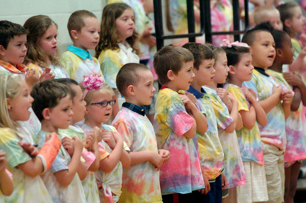 """BRYAN EATON/ Staff Photo. Kindergartners sing """"Let it Shine"""" at the Cashman School on Wednesday morning. They were having their Annual Sing-a-long on the last day of school."""