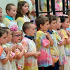 "BRYAN EATON/ Staff Photo. Kindergartners sing ""Let it Shine"" at the Cashman School on Wednesday morning. They were having their Annual Sing-a-long on the last day of school."