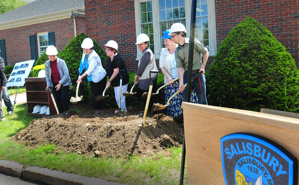 BRYAN EATON/ Staff Photo. Salisbury town officials and residents attended the groundbreaking of the new public library in Salisbury Square on Friday morning. The building is expected to be complete in fall of 2015.