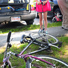 BRYAN EATON/ Staff Photo. Kati Casey, 12, fills a recycled bicycle with air at a bike clinic at Kelleher Park.