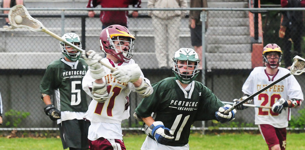 BRYAN EATON/ Staff Photo. Newburyport's Michael Shay throws to a teammate as Pentucket's Kyle Richardson moves in.