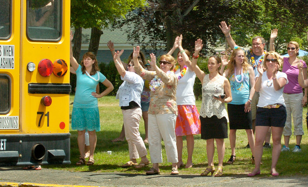 BRYAN EATON/ Staff Photo. Bresnahan School teachers wave goodbye to their students as the school closes for the final time. Students who return in the fall will be at the new Bresnahan School behind the present structure which will be razed and the city's new Senior Center built in its place.