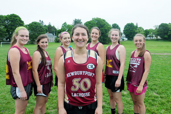 BRYAN EATON/ Staff Photo. Newburyport goalie Izzy Sarra, center, flanked by her defense, from left, Courtney Ryan, Shannon Tinkum, Elizabeth Fortier, Mary Pettigrew, Lily Donovan and Ali Peffer.