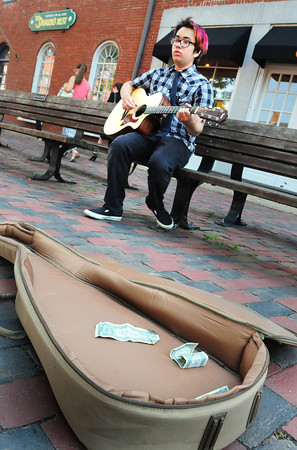 """BRYAN EATON/ Staff Photo. Alex Pascal plays some acoustic music in Newburyport's Market Square on Tuesday afternoon. The Newburyport musician is also in a band """"Secrets Don't Make Friends."""""""