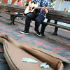 "BRYAN EATON/ Staff Photo. Alex Pascal plays some acoustic music in Newburyport's Market Square on Tuesday afternoon. The Newburyport musician is also in a band ""Secrets Don't Make Friends."""