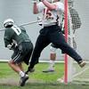 BRYAN EATON/ Staff Photo. Newburyport goalie Dillon Guthro jumps to make a save.
