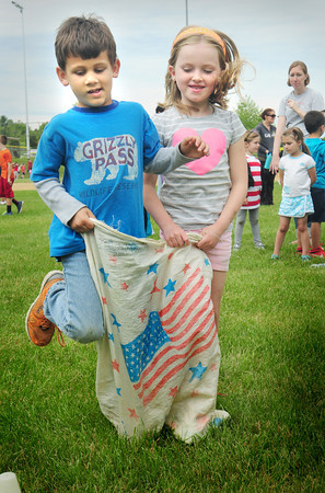 BRYAN EATON/ Staff Photo. Xavier Thompson, left, and Bailey Kimball, both 6, do the Three-legged Race at the Cashman School in Amesbury. There were in the annual Field Days this one for first and second-graders.
