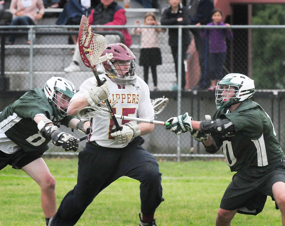 BRYAN EATON/ Staff Photo. Newburyport's Dillon Guthro runs into Pentucket defense as he drives and scores Newburyport's second goal of the game.