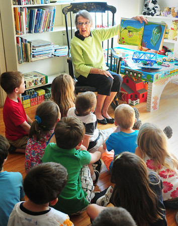 """BRYAN EATON/ Staff Photo. Emma Andrews Library volunteer Janet Murphy reads """"The Butterfly"""" to Brown School kindergartners Tuesday morning. They often take a walking field trip to the library for story hour where a craft is always part of the activity."""