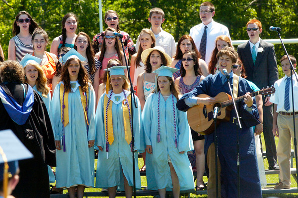 """BRYAN EATON/ Staff Photo. The choral selection was """"This Won't Be The End"""" accompanied by graduate Conner Faucher on the guitar who wrote the song."""