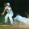 BRYAN EATON/ Staff Photo. Pentucket first baseman Dan Beaton once again has the throw forcing out a diving Lynnfield player.