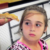 BRYAN EATON/ Staff Photo. Makayla Hoffman, 10, checks out Sonny, a crested gecko at the Hilton Center in Salisbury. Students from Salisbury Elementary School's afterschool program Kids Club were visiting with seniors for a presentation of Curious Creatures.