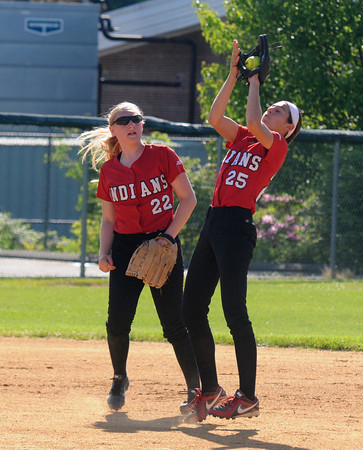 JIM VAIKNORAS/Staff photo Amesbury's Madison Napoli catches a pop up with Autumn Kligerman standing by at Martin Field in Lowell Sunday. The Indians lost the game 8-4.