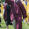 JIM VAIKNORAS/Staff photo Newburyport high graduate Andrew Beaupre points to the crowd after getting his diploma Sunday at War Memorial Stadium.