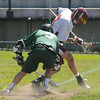 JIM VAIKNORAS/Staff photo Newburyport's Drew Bourdeau and Austin Prep's Brett Mazza kick up some dirt on a face off during their game at War Memorial Stadium in Newburyport Saturday.