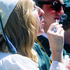 JIM VAIKNORAS/staff photo Graduate Haley Collins blows bubbles at Pentucket's Commencement Saturday at the high school in West Newbury.