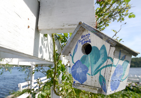 JIM VAIKNORAS/Staff photo  A bird house in the garden of Jim and Sally Chandler at 417 Main Street in Amesbury.