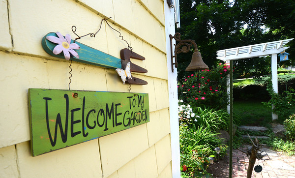 JIM VAIKNORAS/Staff photo  A welcome sign in the garden of Mickey and John Rizza at 418 Main Street in Amesbury.