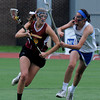JIM VAIKNORAS/Staff photo Newburyport 's Julia Kipp is guarded by Bromfield's Jacqueline Planchet Saturday.The Clippers won the state championship 7-6 over Bromfield at Boston University.