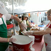 JIM VAIKNORAS/Staff photo Jim Smith, Jane Church, and Dee Morse assemble Strawberry Shortcakes  at the Amesbury Days Strawberry Shortcake Festival at the Main Street Church Saturday.