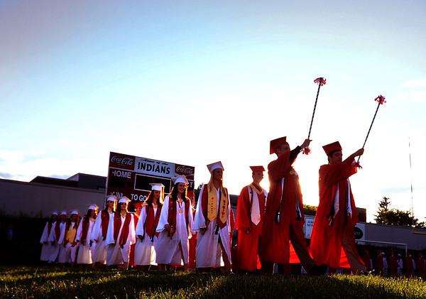 JIM VAIKNORAS/Staff photo Amesbury's graduating class march into Landry Stadium.