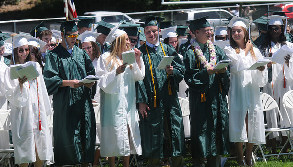 JIM VAIKNORAS/staff photo Graduates sing Alma Mater at Pentucket's Commencement Saturday at the high school in West Newbury.