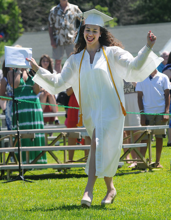JIM VAIKNORAS/staff photo Graduate sara Maloney does a happy dance after getting her diploma at Pentucket's Commencement Saturday at the high school in West Newbury.