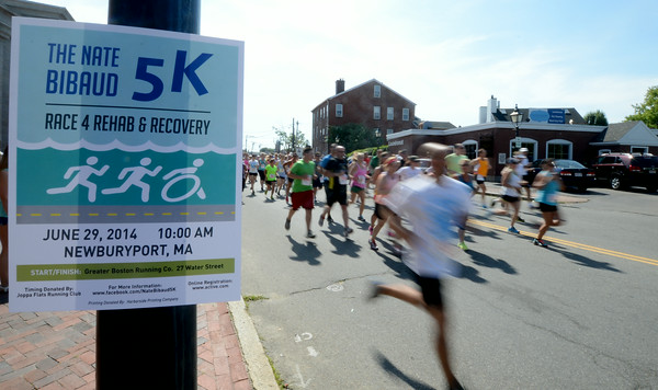JIM VAIKNORAS/Staff photo  Runners take off on Water Street in Newburyport at the start of the  Nate Bibaud 5K Race 4 Rehab & Recovery Sunday morning.