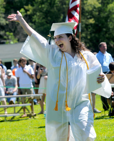 JIM VAIKNORAS/staff photo Graduate Melissa Kowalick waves after getting her diploma at Pentucket's Commencement Saturday at the high school in West Newbury.