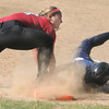 JIM VAIKNORAS/Staff photo Amesbury's Zoe Fitzgerald tags out Notre Dame's Regan Szekely at first during their game at Amesbury Middle School Tuesday.