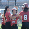JIM VAIKNORAS/Staff photo Amesbury's Alexis Boswell is congratulated by her teammates after scoring a run in the 4th inning of their game against Notre Dame at Amesbury Middle School Tuesday.