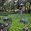 JIM VAIKNORAS/Staff photo  Bird feeders in the garden of Joe and Carol Flynn at 412 Main Street in Amesbury.