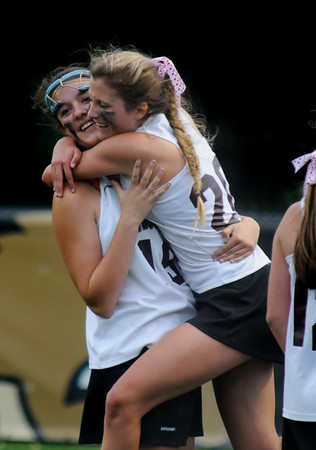 JIM VAIKNORAS/Staff photo Newburyport's Olivia Kearney hugs teammate Mary Pettigrew after the Clippers win over Norwell at Babson College in Wellesley Monday night. They will play for the state title Saturday at BU.