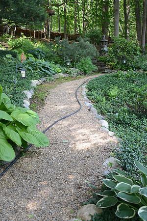 JIM VAIKNORAS/Staff photo  A path through the garden Joe and Carol Flynn at 412 Main Street in Amesbury.