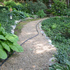 JIM VAIKNORAS/Staff photo  A path through the garden Joe and Carol Flynn at 412 Main Street in Amesbury.