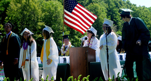 JIM VAIKNORAS/staff photo Valedictorian Megan Migliozzi,center, used 5 of her fellow graduates as backup singers to give her musical address at Pentucket's Commencement Saturday at the high school in West Newbury.